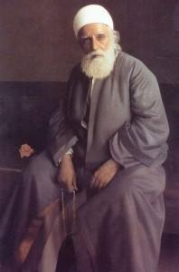 'Abdu'l-Baha sitting
