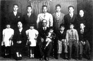 This family photograph was taken in 1919 on the eve of Mr. Yamamoto's departure from Yamaguchi Prefecture to go back to the United States with four of his sons. In the back row are Hiroshi, Yamamoto's younger sister. Mr. Yamamoto and his second sister. In the front row a cousin, then Shinji (who gave us this picture), Yamamoto's oldest sister holding a baby (unidentified). Masao, Mr. Yamamoto's mother holding Fumiko, Michiaki and a relative holding Goro. Source: bahai-library.com