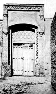 The entrance door to the ruined home of Hujjat